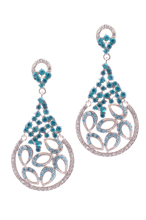 sumptuousness: Gold earrings inlaid with precious stones on a white background