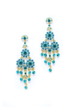 sumptuousness: earrings with blue gem isolated on white background