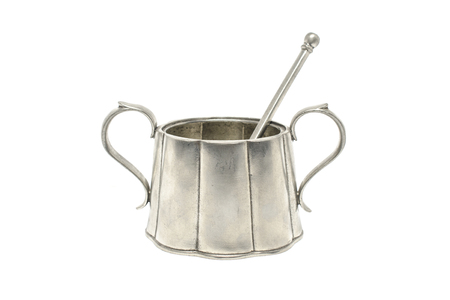 dollop: retro sugar bowl with a spoon isolated on white