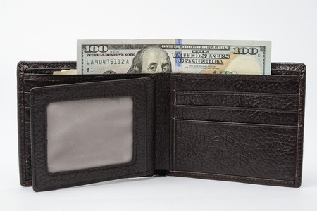 afford: wallet with money isolated on white