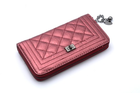 maroon leather: maroon clutch purse isolated on a white