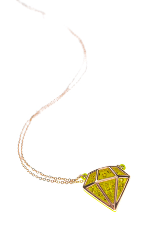 coulomb: pendant in the shape of a diamond on a white background