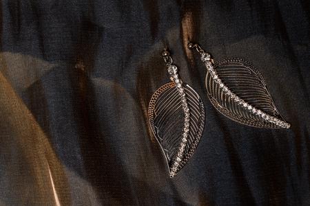 dearness: earrings leaves beautiful background Stock Photo
