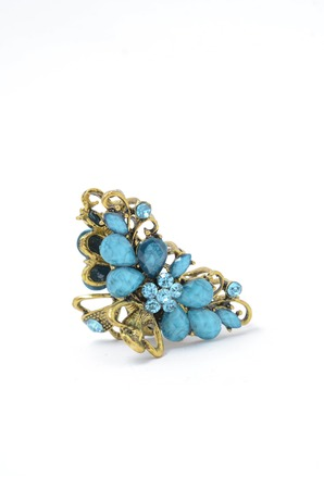 spinel: barrette with blue stones on white background