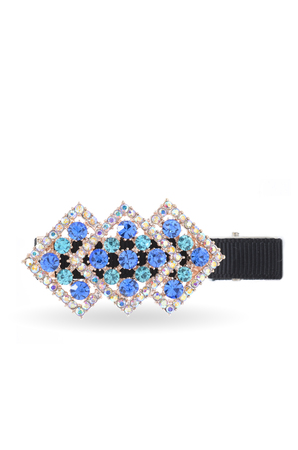 barrette: barrette with blue stones on white background