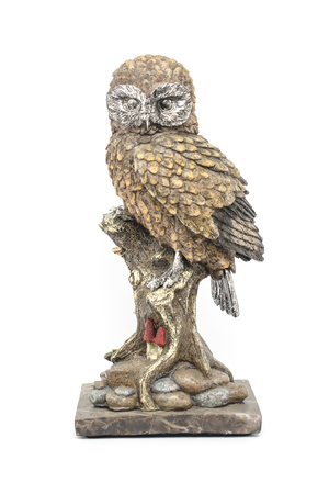 statuette: owl statuette isolated on white