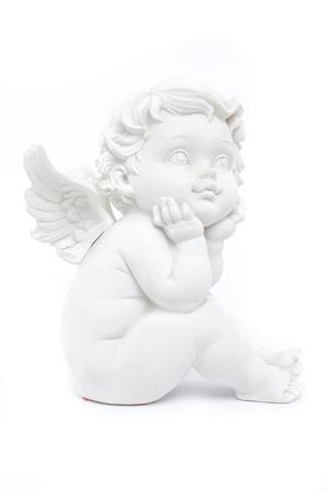 statuette: cherub statuette isolated on white