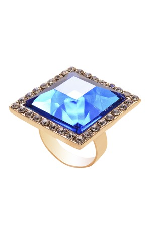 ring with a blue stone on a white background