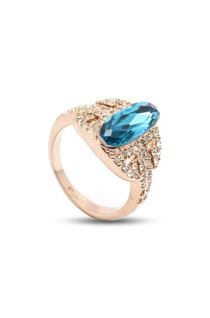 rubellite: ring with a blue stone on a white background