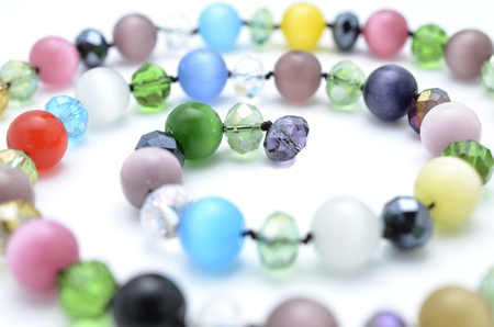 stones isolated: beads from natural stones isolated Stock Photo