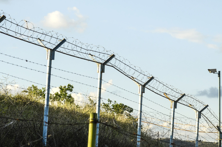 wire fence: Barbed wire, fence, videocamera Stock Photo