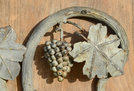 bunch of grapes and leaves  wrought iron Stock Photo - 57690351