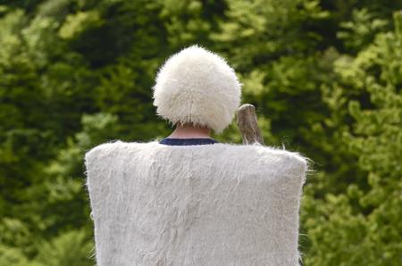 papakha: Georgian shepherd in a white cloak, burka