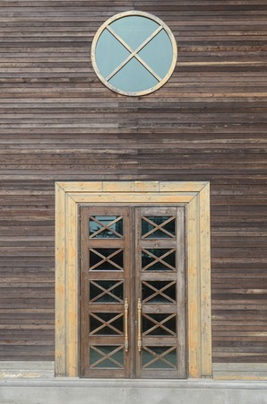 round window: House wooden door with round window