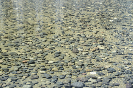 shallow: Stones under water, shallow with pebbles