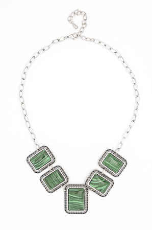 coulomb: necklace with green stones isolated on white