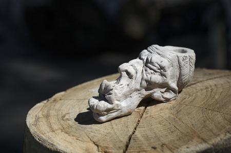 peace pipe: smoking pipe, Indian head, clay figurine