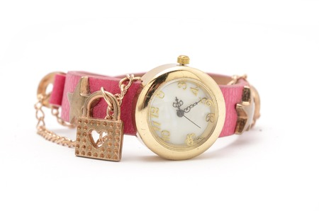 Wrist watch with pink strap isolated on white