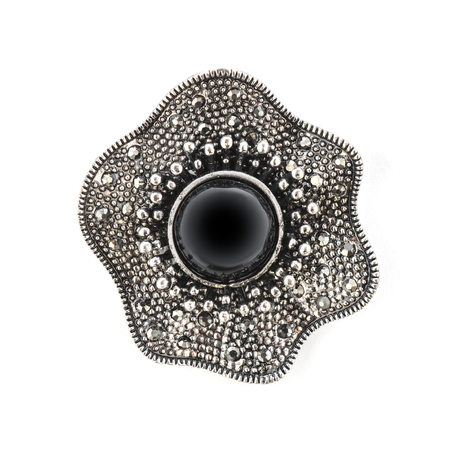 onyx: brooch with black stone isolated on white