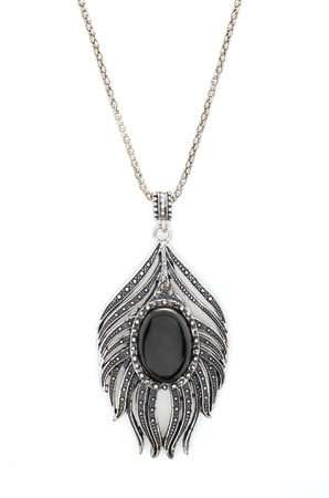 onyx: silver pendant with feather isolated on white