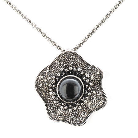 coulomb: pendant with black stones isolated on white Stock Photo