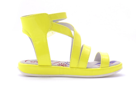 varnished: yellow sandals for girls isolated on white