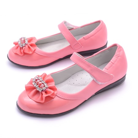 Children pink shoes isolated on white