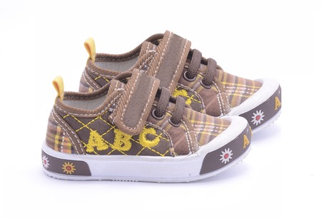baby brown sneakers isolated on white