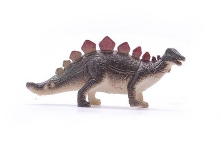 stegosaurus: Stegosaurus dinosaurio de juguete aislado en blanco