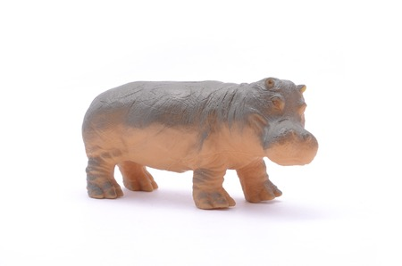plaything: hippopotamus toy isolated on white