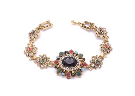 piedras preciosas: bracelet with precious stones isolated on white Foto de archivo