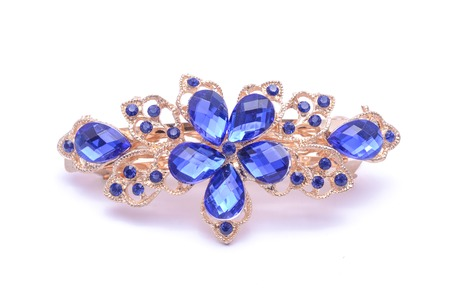 broach: gold brooch with blue stones isolated on white Stock Photo