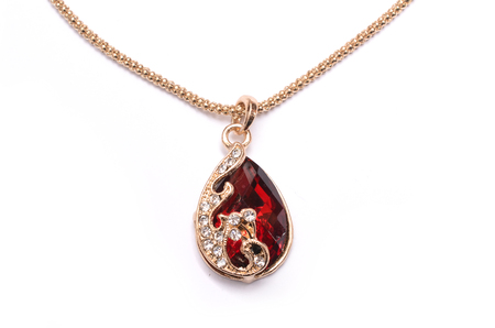 gold pendant with ruby isolated on white