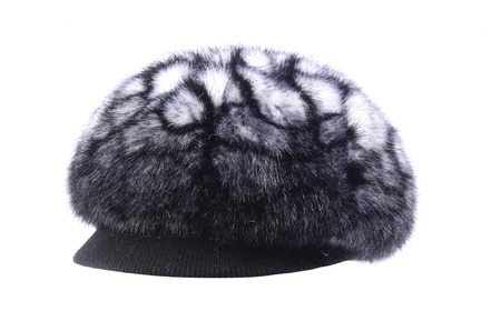 visor: Womens fur hat with a visor is isolated on white