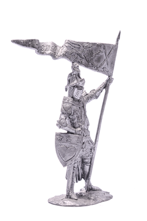 tin soldier medieval knight with sword and shield isolated on white Stock Photo