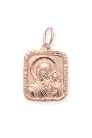 personal ornaments: Gold pendant with the Virgin Mary isolated on white