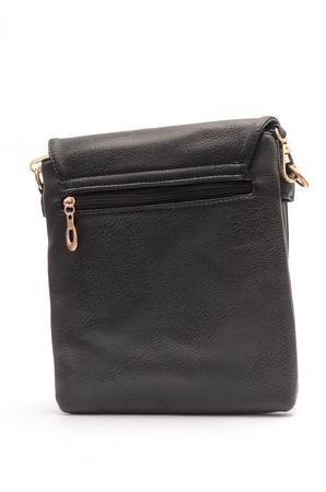 Black leather clutch classic rectangular shape. It stands on a white background in the studio. It stand in a half-turn.