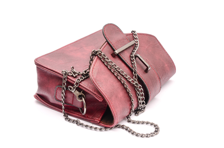 clutch bag: burgundy leather clutch with chain isolated on white Stock Photo