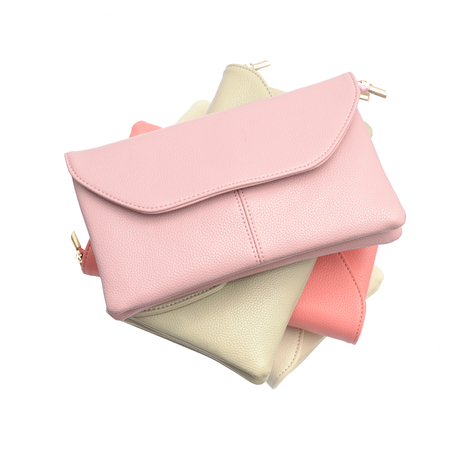 clutch bag: stack of leather clutch isolated on white