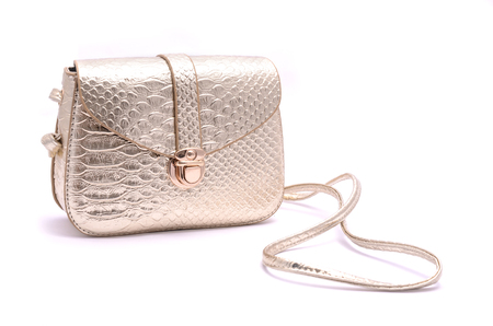 clutch bag: Golden leather clutch isolated on white