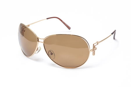 aviators: Sunglasses in an iron frame with brown glass isolated on white