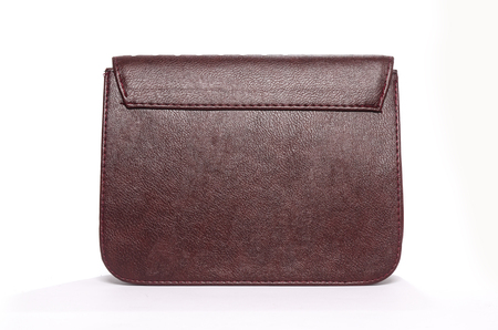 leather clutch with a pattern isolated on white Stock Photo