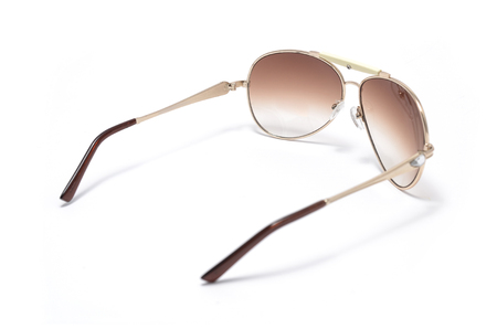 eighties: Sunglasses in an iron frame with brown glass isolated on white