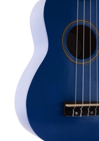resonator: Ukulele guitar detail , four strings .