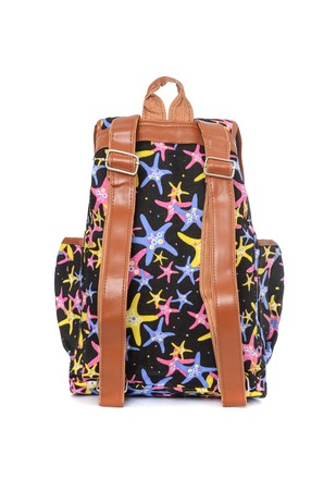 Black backpack with starfish pattern isolated on white Stock Photo