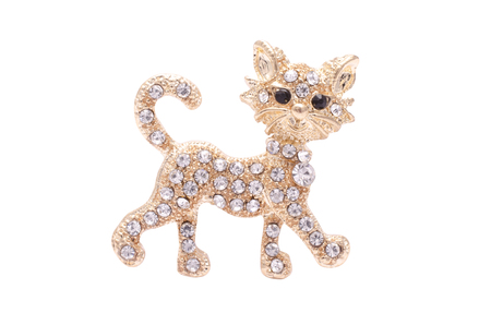 Brooch golden kitten with diamonds isolated on white