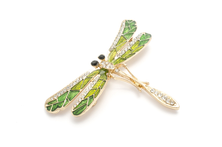 enamel brooch with golden dragonfly with diamonds isolated on white