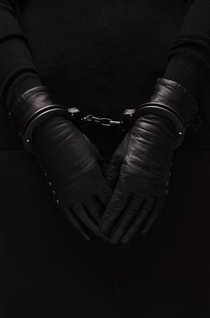arrestment: Black handcuffs leather black gloves, concept