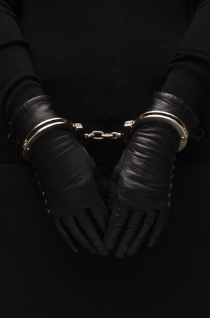 arrestment: Silver handcuffs leather black gloves, concept