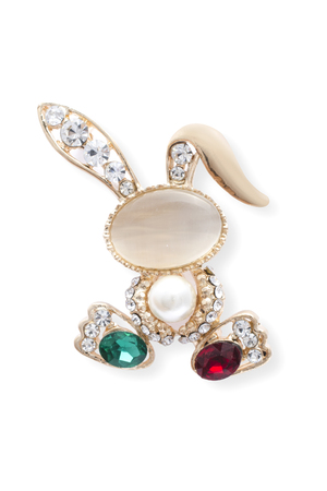 Golden brooch bunny with diamonds and moonstone isolated on white